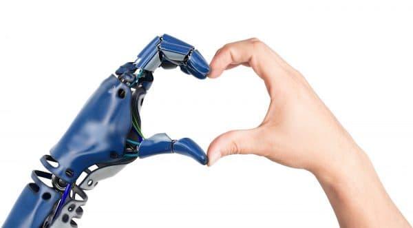 Robothand en mensenhand vormen hart voor TriFact365 en Snelstart digitale declaraties en het met 1 klik journaliseren.
